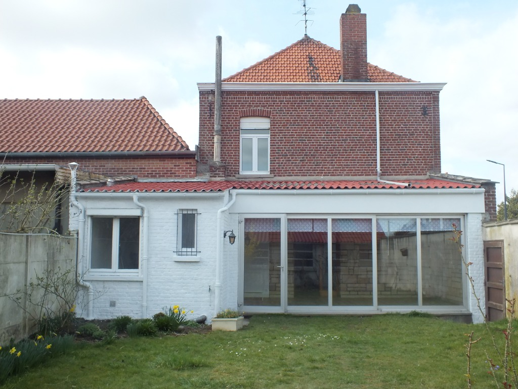 Vente maison - Maison ancienne semi individuelle rénovée 4 chambres